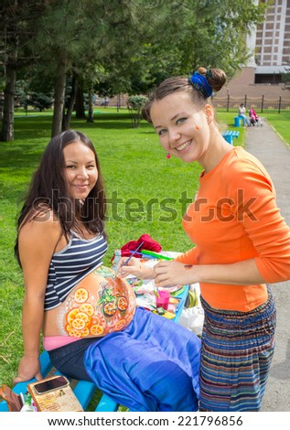 Pregnant girl walking in park