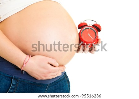 Pregnant girl with clock due date concept - stock photo