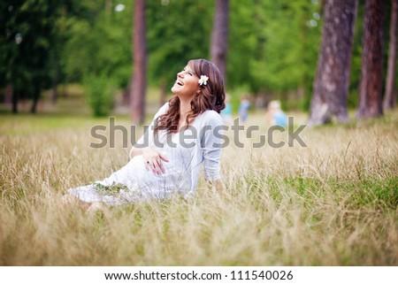 pregnant outdoors - stock photo