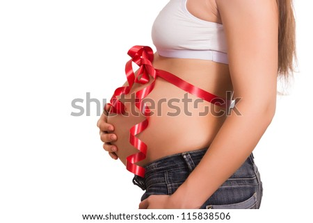 pregnant tummy tied up by a red gift tape