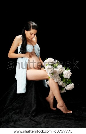 pregnant with roses on black background - stock photo