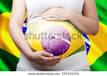 pregnant woman and brazilian flag - stock photo