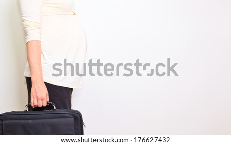 Pregnant woman at work with laptop - stock photo