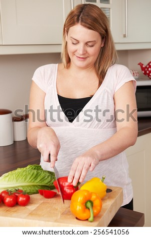 Pregnant Woman Chopping Up Fresh Vegetables