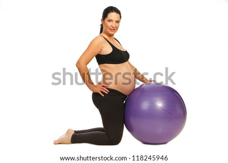 Pregnant woman doing fitness exercises isolated on white background