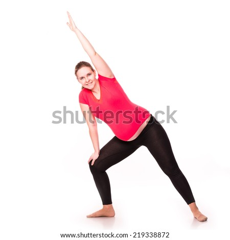 Pregnant woman doing gymnastic exercises isolated over white background, active and sportive pregnancy, healthy motherhood concept - stock photo