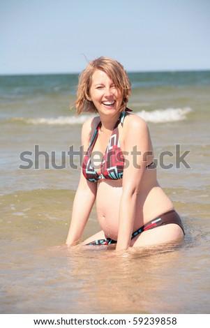 Pregnant woman enjoying her summer - stock photo