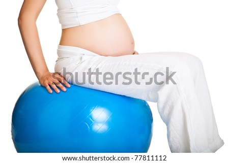 Pregnant woman exercises with gymnastic ball - stock photo