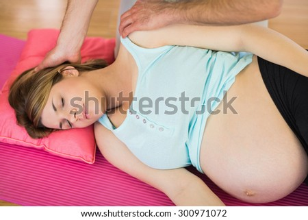 Pregnant woman having relaxing massage in a studio