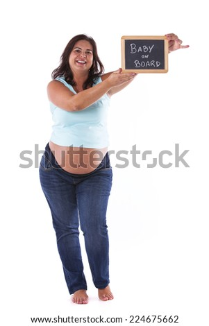 Pregnant woman holding a chalkboard with the message Baby on Board - stock photo