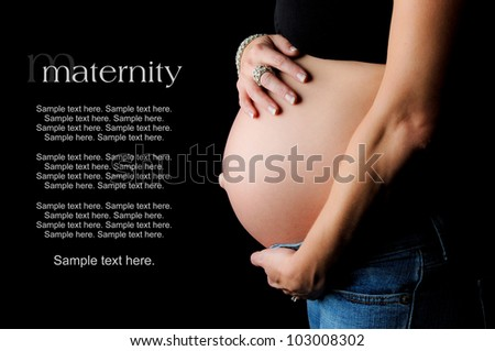 pregnant woman holding her belly with text space to the left - stock photo
