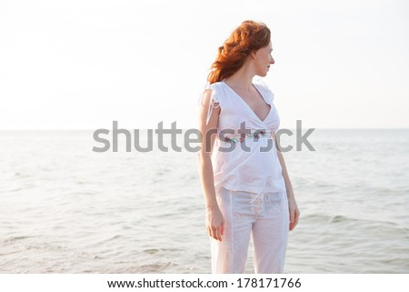 pregnant woman in beach with white light in Mediterranean Spain