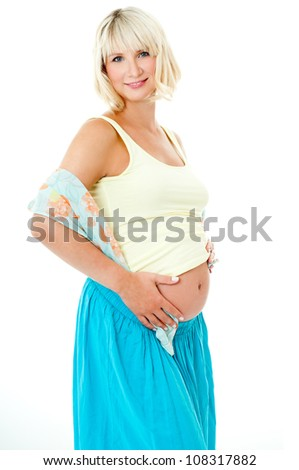 Pregnant woman in bright clothes - stock photo