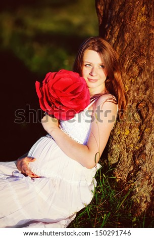 pregnant woman in summer garden, sunny picture - stock photo