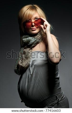 pregnant woman in sunglasses - stock photo