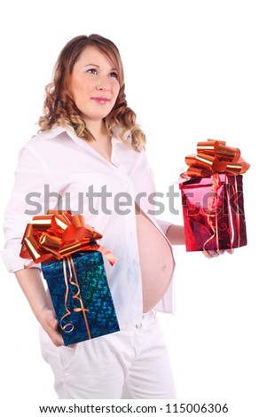 Pregnant woman in white holds two boxes with gifts isolated on white background.