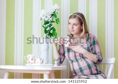 Pregnant woman is drinking tea - stock photo