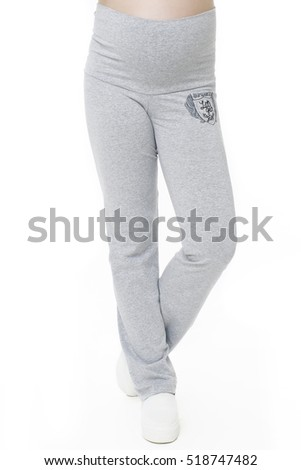 Pregnant woman legs in gray pants