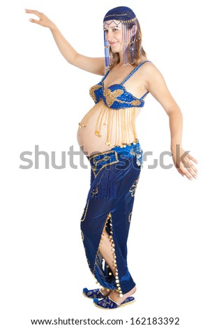 pregnant woman (9 months) practicing belly dancing for strength in anticipation of child birth. Isolated on white