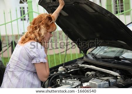 pregnant woman near the broken car - stock photo