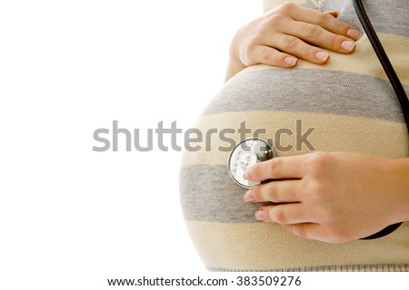 pregnant woman on a white background with a stethoscope