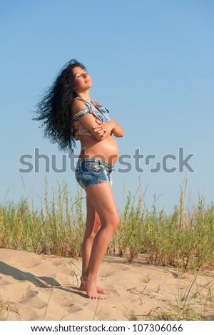 Pregnant woman, outdoors portrait - stock photo