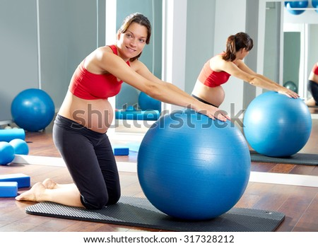 pregnant woman pilates fitball exercise workout at gym indoor - stock photo