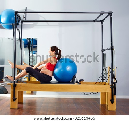 pregnant woman pilates reformer fitball exercise workout at gym - stock photo