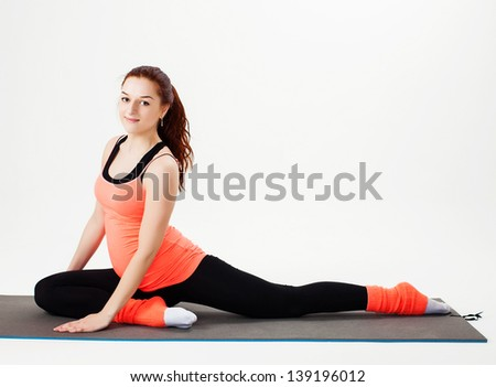 pregnant woman practicing physical exercise