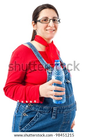 Pregnant woman with a bottle of water isolated on white background