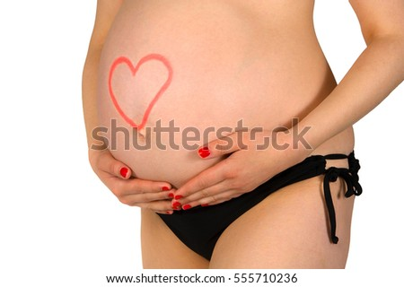 Pregnant woman with a heart written with lipstick on her belly