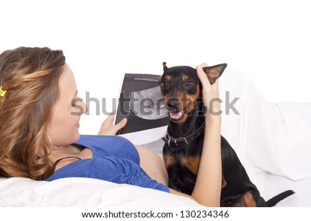 pregnant woman with dog - stock photo