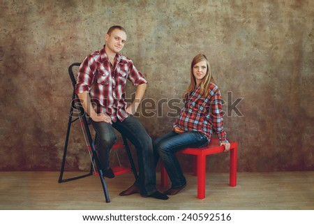 pregnant woman with her husband in studio - stock photo
