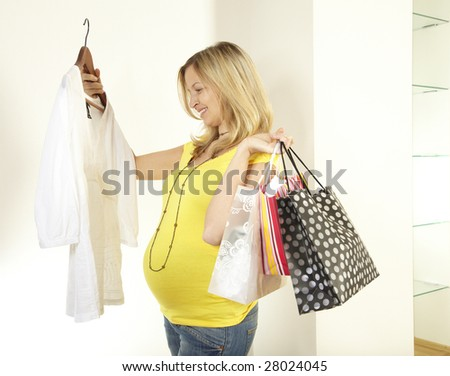 pregnant woman with purchase bags
