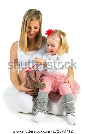 Pregnant woman with 2 zo daughter on white - stock photo