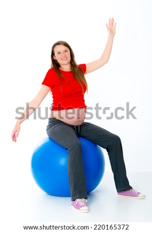 pregnant young woman taking exercise  - stock photo