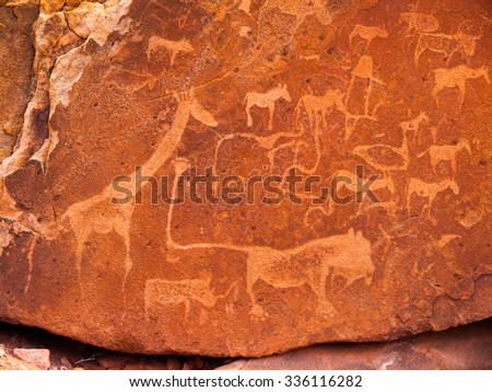 Prehistoric Bushman engravings - Lion Plate with Lion Man and other animals and symbols, Twyfelfontein, Namibia - stock photo