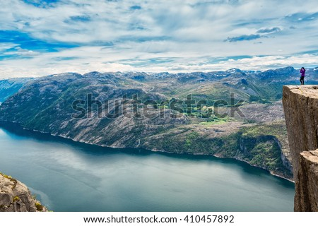Preikestolen or Prekestolen, also known by the English translations of Preacher's Pulpit or Pulpit Rock, is a famous tourist attraction in Forsand, Ryfylke, Norway - stock photo