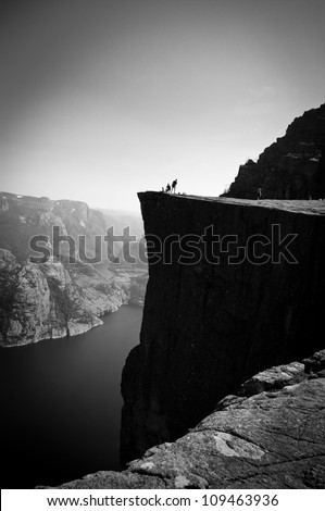 Preikestolen - pulpit rock above Lysefjord in Norway. - stock photo
