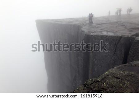 Preikestolen rock taken in deep fog, Norway fjord - stock photo