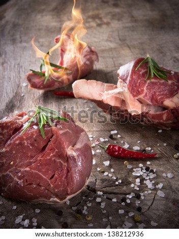 Premium Raw beef meat on wooden table - stock photo