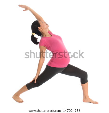 Prenatal yoga class. Full length healthy Asian pregnant woman doing yoga exercise stretching at home, full body isolated on white background.  - stock photo
