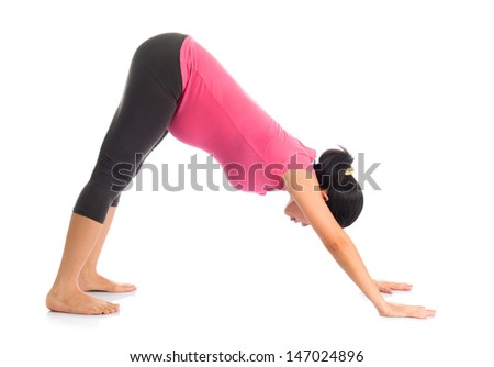 Prenatal yoga meditation. Full length healthy Asian pregnant woman doing yoga meditation at home, full body isolated on white background. Yoga facing downward dog positions. - stock photo