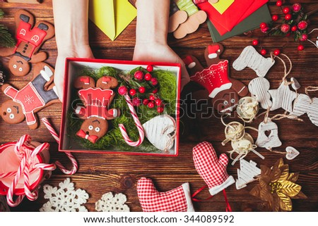 Preparation a Christmas gift box for friends - stock photo