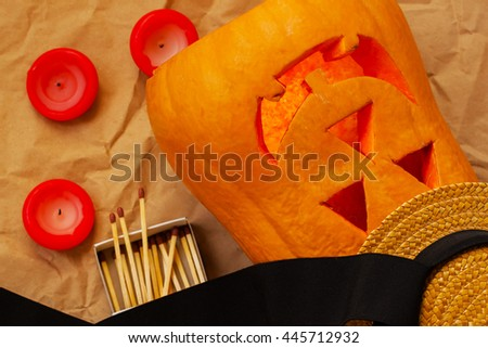 Preparation before holiday Halloween scary pumpkin - stock photo