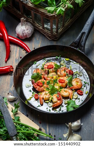 Preparation for cooking shrimps with herbs - stock photo