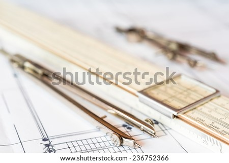 Preparation for drafting papers, the tools and schemes on the table. Angle view - stock photo