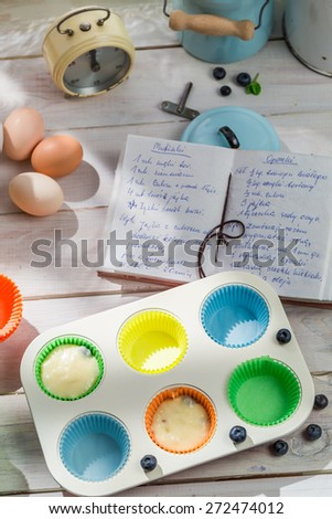 Preparation for sweet muffins with berry fruits - stock photo