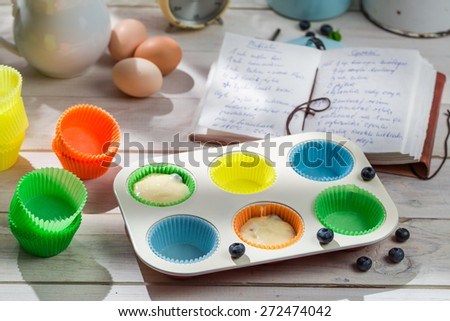 Preparation for sweet muffins with blueberries - stock photo