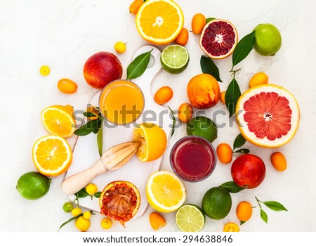 Preparation fresh citrus juices. Top view - stock photo